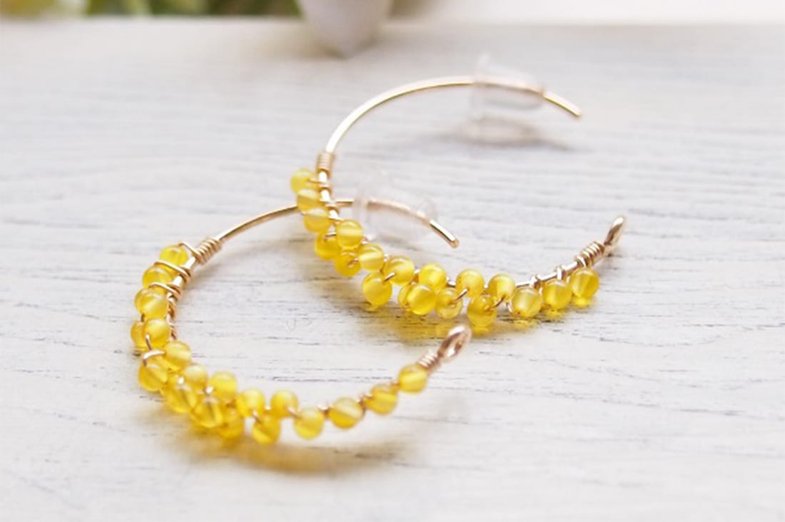 perle-accessoryさんのイエローカルセドニーのピアス