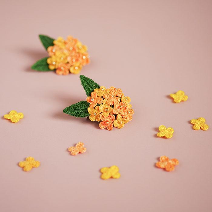 四季折々さんの刺繍糸で編んだ金木犀のブローチ