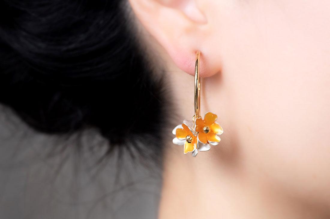 レモンソーダさんの金木犀の花のフープイヤリング