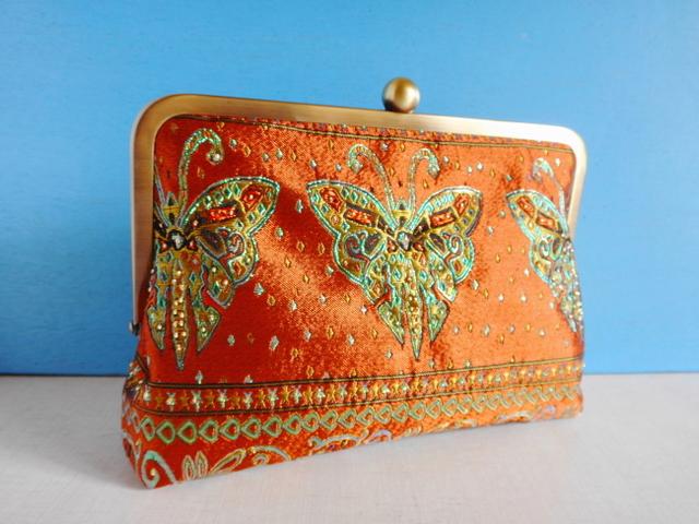 チュニジア布のがま口クラッチバッグ 蝶々オレンジA