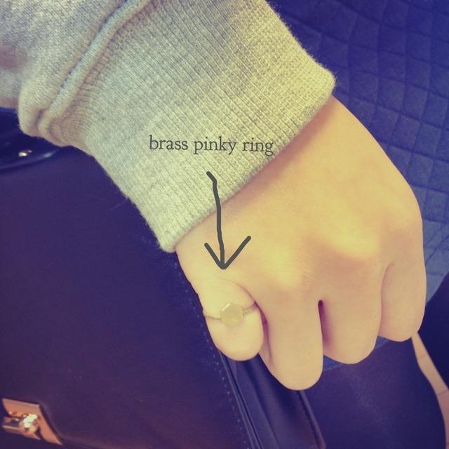 Brass pinky ring.