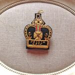 Pridia crown brooch