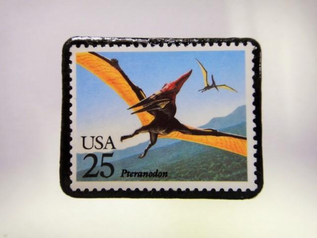 アメリカ 恐竜切手ブローチ 554