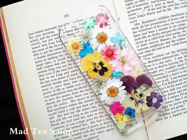 ビオラとノースポールのお花畑iphone5.5sカバー