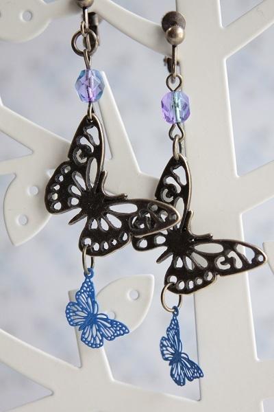 W蝶々チャームのイヤリングorピアス(ブルー)