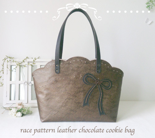 race pattern leather chocolate cookie bag