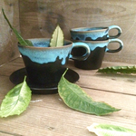 Flowing blue cup & saucer