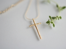 Delicate simple cross necklace