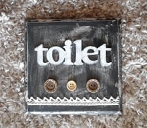 黒板色のトイレサインボード