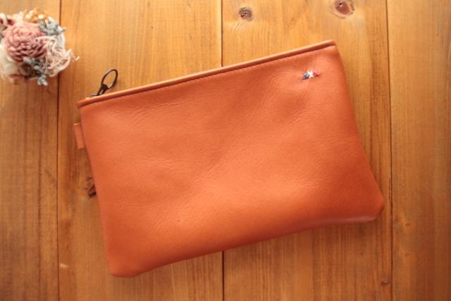 984 牛革のポーチ -オレンジブラウン-...