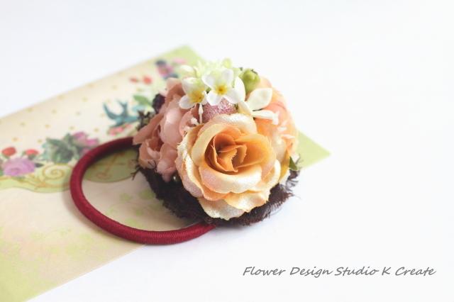 シャンパンオレンジのお花のヘアゴム(M...