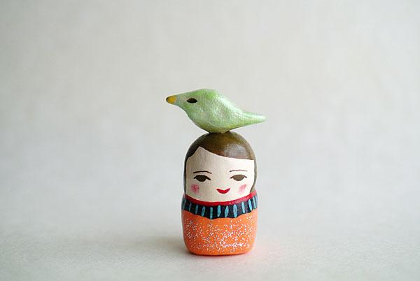小鳥乗せのオレンジのひと