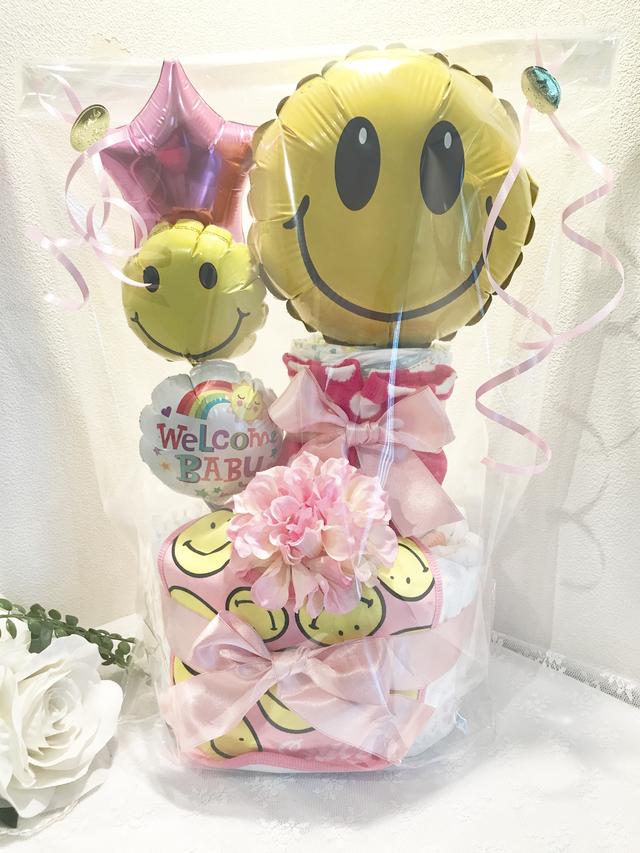 豪華出産祝い■バルーンスマイルおむつケーキ■スマイリーニコちゃんピンクスタイ付き
