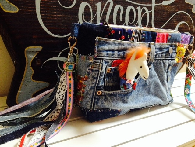 Denim clutch of a white horse