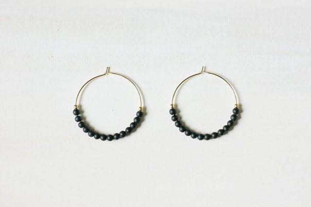 black beads pierce