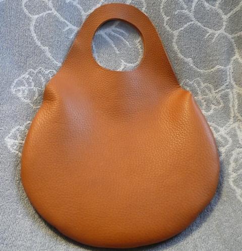 革の袋・有機デザインのキャメルバッグ NEW!