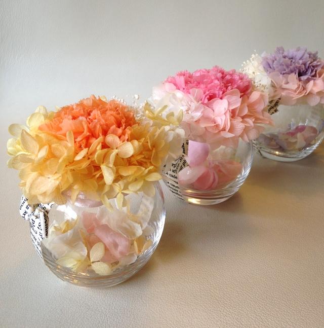 《再販》カーネーション??candy pot flower 花びら入りアレンジ(オレンジ)