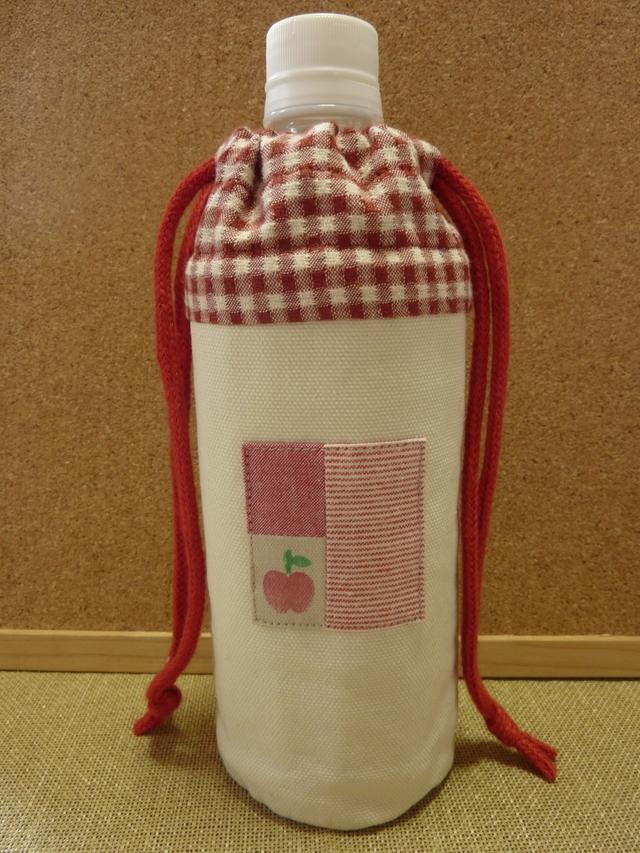 赤いりんごのペットボトルケース