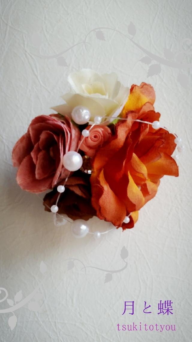 花のコサージュ オレンジ