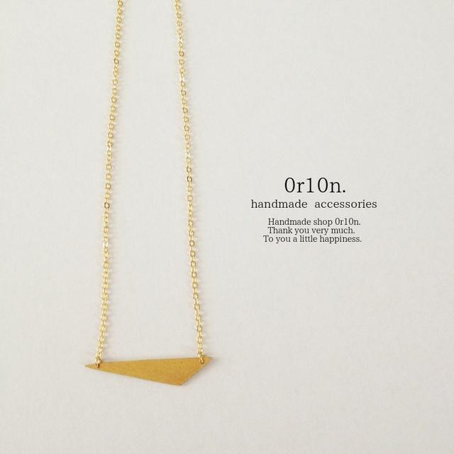 Brass necklace.