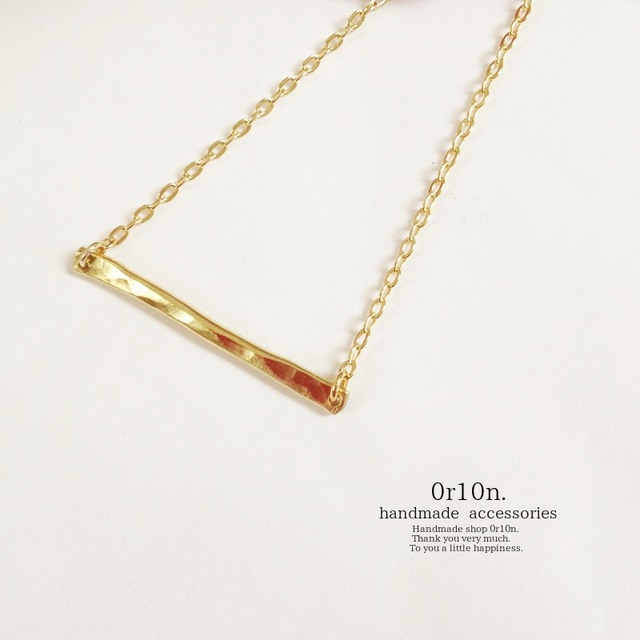 Brass bar necklace.
