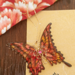 命の蝶のネックレス ~紅梅と椿〜(Necklace of「life of butterfly」〜Red plum&Camellia〜) .