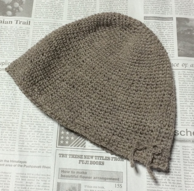 薄いベージュの帽子