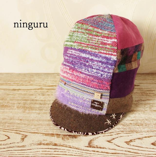 手織りパープルの背高帽子?